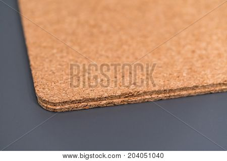 Two cork texture boards on grey background with shallow dept of field. Selective focus