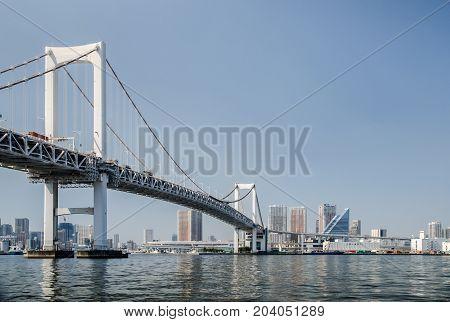 Rainbow Bridge Is A Bridge On Tokyo Bay Between Shibaura Pier And The Odaiba Waterfront. Tokyo, Japa