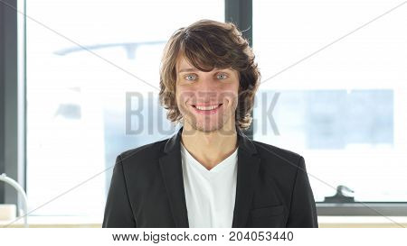 Smiling Satisfied Businessman In His Office At Work