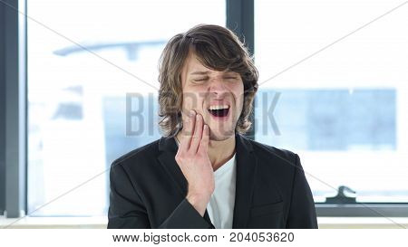 Toothache, Man In Pain Of Teeth  In His Office