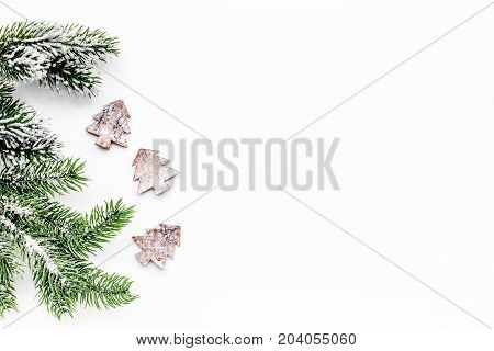 Christmas eve set with spruce branches and fur tree toys on white desk background top veiw mock-up