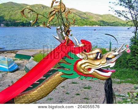 Dragon head at the top of a dragon boat at Silver Mine Bay Beach in Mui Wo on the island of Lantau (Hong Kong)