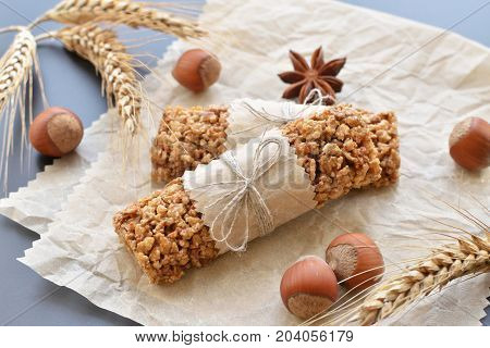 two muesli bars with filbert nuts anise star wheatear on backing parchment background