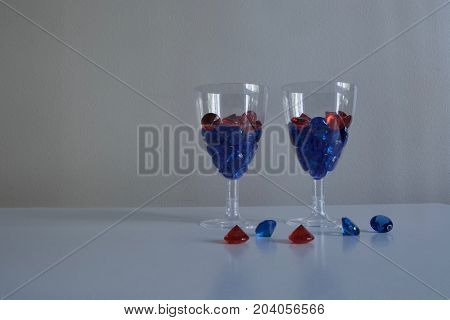 Two wineglasses with beautiful blue and red diamonds
