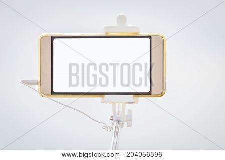 Mobile Phone on tripod isolated on a light background. Copy space