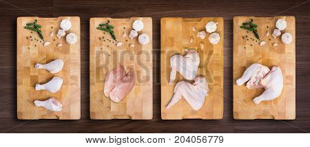 set of chicken on cutting board with wooden background with clipping path