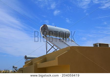 Systems for heating water from sunlight ( sun collectors) on roofs of hotel in Marsa Alam, Egypt