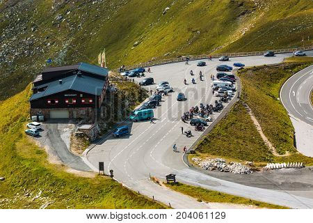 ALPS, AUSTRIA - 27.08.2017: Tourists at the mountain hut on the Grossglockner high alpine road is the highest mountain road in Austria