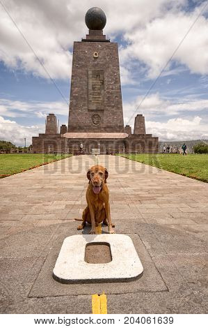 March 2 2017 Quito Ecuador: the monument marking the zero latitude in the Mitad del Mundo is dog friendly tourist destination