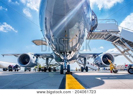 aircraft gets prepared for take off under a sunny sky