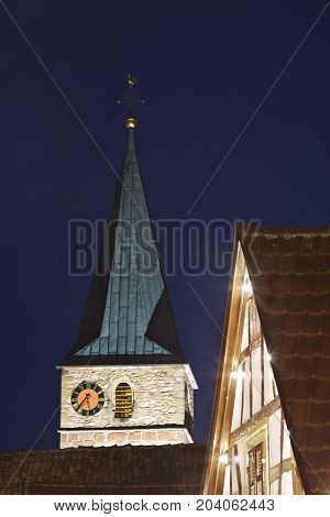 Church In A Christmas Village At Night, Germany