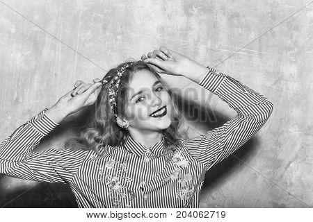 Cheerful Pretty Girl In Blue Striped Shirt Ties Headband