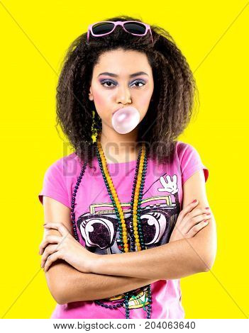 Young woman american africa bubblegum yellow background