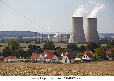 Nuclear Power Station Behind Living Houses