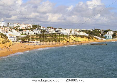 Albufeira Algarve Portugal - October 26 2015 : People enjoying the sun on Albufeira Beach