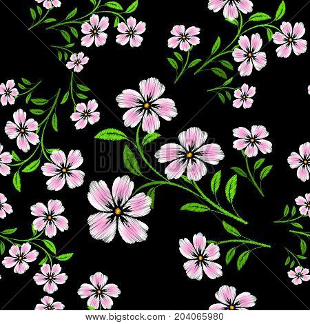 Seamless pattern consisting of embroidered pink white flowers. Raster copy.