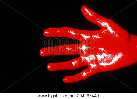 Red Hand close up on black background