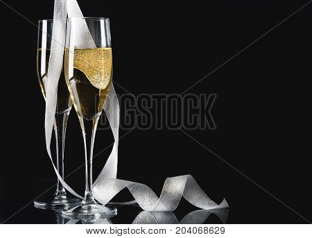 Ribbon curly champagne glasses bar color background