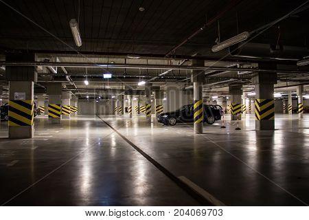 Illuminated Underground Car Park, Parking Spaces In The Car Park.