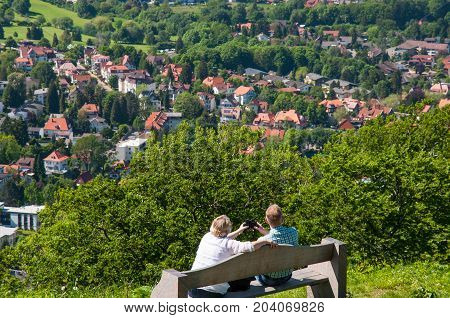 Couple Enjoying The View Over Bad Harzburg From Burgberg
