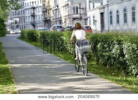 Young women riding a bike in the city