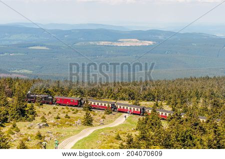 Brocken Germany - May 27. 2017: Steam train climping the tracks towards the top of Brocken Mountain