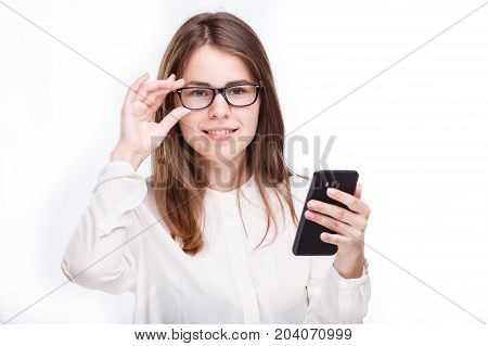 Portrait happy, smiling woman texting on her smart phone, isolated white background. Communication concept. Positive facial expressions, emotion, feelings, good news. Internet, phone addiction
