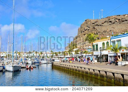 PUERTO DE MOGAN SPAIN - SEPTEMBER 27 2013: Port and promenade of beautiful romantic picturesque village Puerto de Mogan on Gran Canaria on September 27 2013 in Puerto de Mogan Spain.