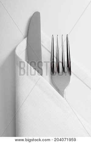 Knife cloth fork table white background shiny