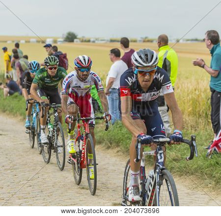 QuievyFrance - July 07 2015: Environmental portrait of the Portuguese cyclist Tiago Machado of Katusha Team inside the peloton riding on a cobblestoned road during the stage 4 of Le Tour de France 2015 in Quievy France on 07 July2015.
