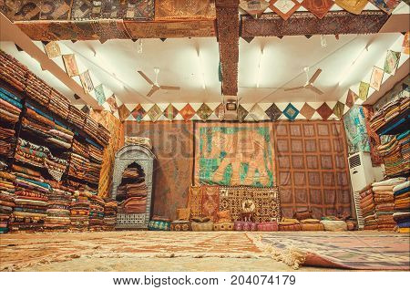 JAIPUR, INDIA - JAN 22, 2015: Store with raditional Indian souvenirs silk shawls carpets and textile of different materials on January 22, 2015. Jaipur with population 6664000 is capital of Rajasthan