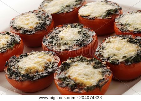 Stuffed tomatoes with cheese baked in the oven