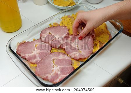 Preparing meal specialties with fresh smoked ham