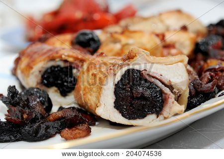 Delicious chicken specialty with plums on the plate