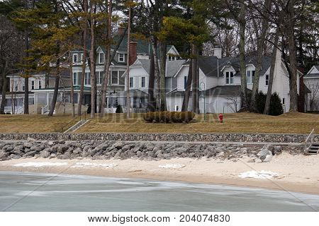 A view of beachfront homes on Beach Drive in Wequetonsing, Michigan, during March.