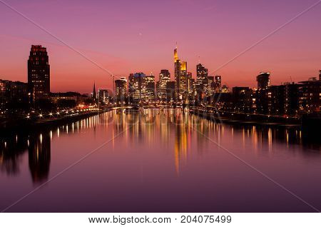 Frankfurt am Main, Hessen, Germany - March 16, 2017: Frankfurt am Main city skyline during blue hour in Frankfurt, Germany