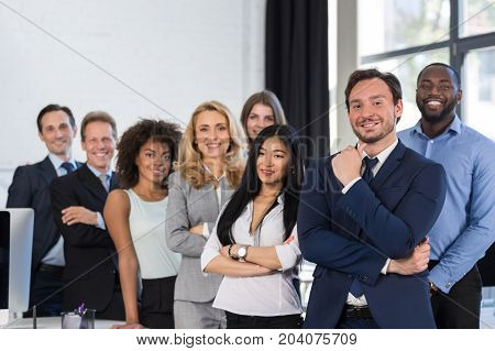 Mix Race Business People Group Standing At Modern Office, Businesspeople Happy Smiling Businessman And Businesswoman Colleague Team With Leader Boss Folded Hands