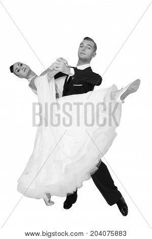 dance ballroom couple in a dance pose isolated on white background. sensual professional dancers dancing walz tango slowfox and quickstep. black and white