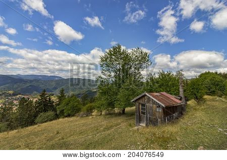 beauty daily landscape of alone old wooden house on a hill in a mountain