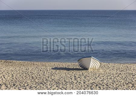 lonely wooden boat on the beach. Day view