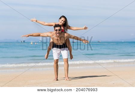 Couple On Beach Summer Vacation, Young People Happy Smiling, Man Carry Woman Sea Ocean Holiday Travel