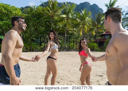 Two Couple On Beach Summer Vacation, Young People In Love Walking, Man Woman Holding Hands Sea Ocean Resort Holiday Travel