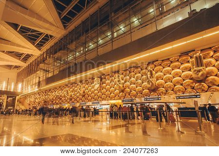 DELHI, INDIA - JAN 21, 2016: Motion blurs from walking passengers inside the International Airport of Delhi on January 21 2016. Indira Gandhi International Airport is the 32th busiest in the world.