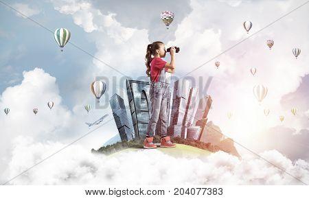 Cute kid girl on city floating island looking in binoculars