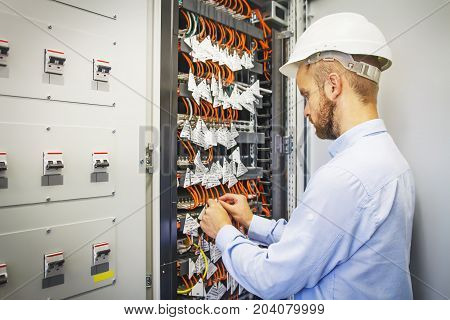 Engineer in server room of datacenter. Networking service. network engineer administrator checking server hardware equipment of data center.