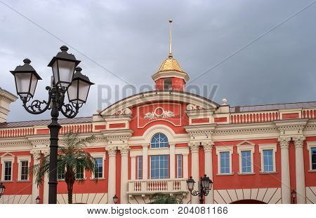 St. Petersburg, Russia - August 26, 2017: Fragment of the building of the shopping complex Outlet Village Pulkovo. The building is richly decorated with columns and stucco molding.
