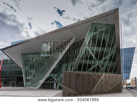 Dublin Ireland - August 7 2017: New modern building of Bord Gais Energy Theater on Grand Canal Square. Glass Triangles and other shapes. Street scene.