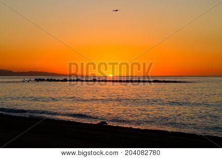 Barceloneta Beach in Barcelona with colorful sky at sunrise