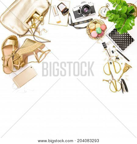 Fashion flat lay. Feminine golden accessories bag shoes office tools no name photo camera on white background