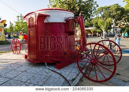 POMORIE BULGARIA - AUGUST 17 2017: A souvenir point in the form of a stylized coach on the central street of Knyaz Boris I in the old town of Pomorie.